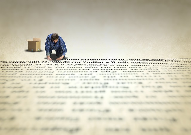 man putting words on paper